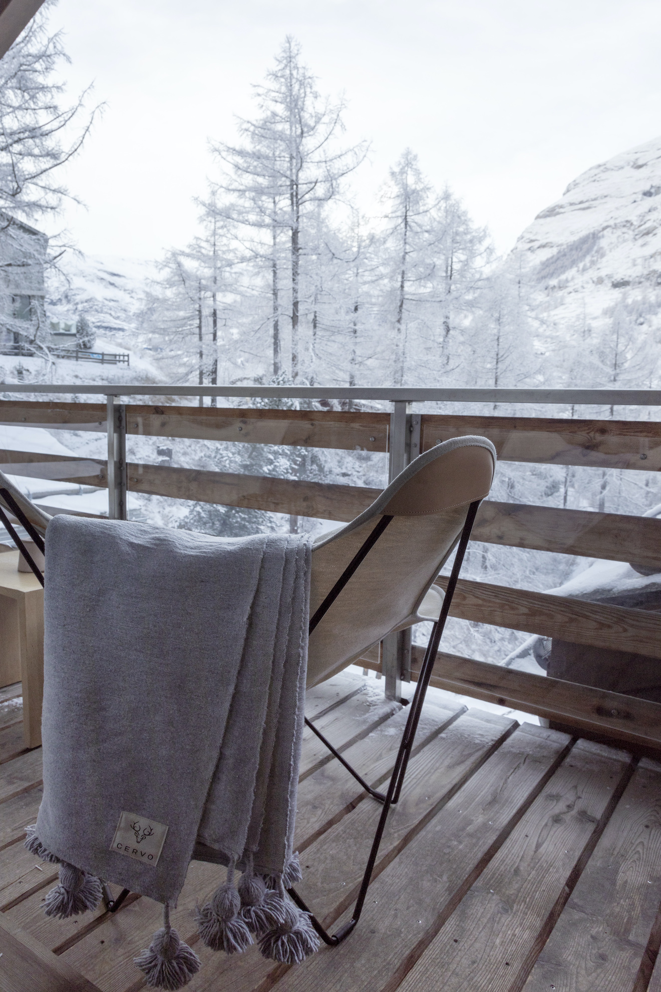 Balcony in winter with chair and blanket