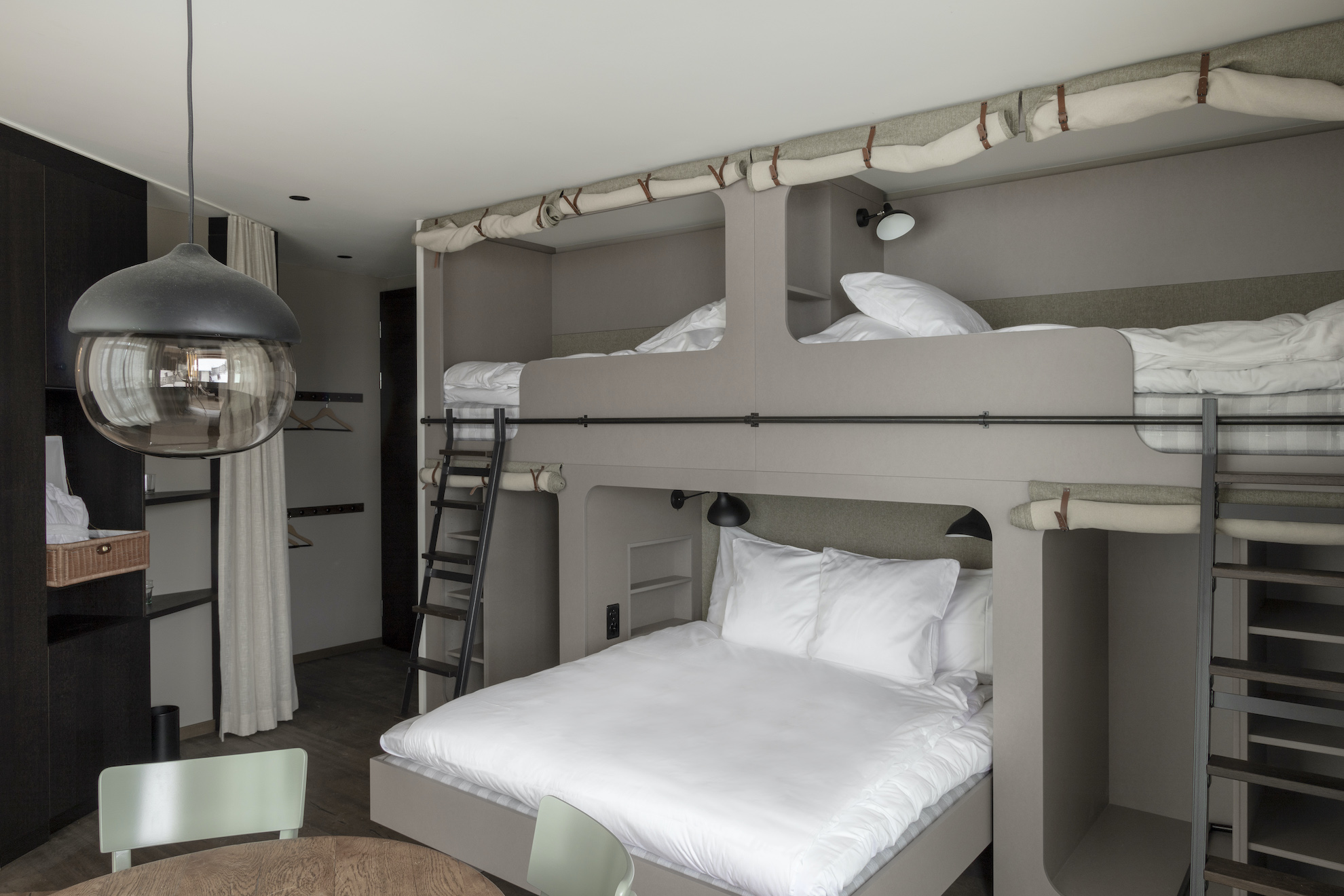 Room with king size and bunk beds